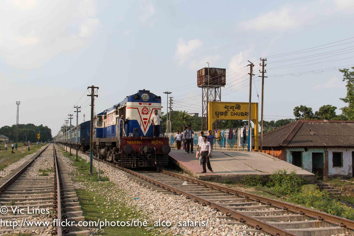 how to go assam by train